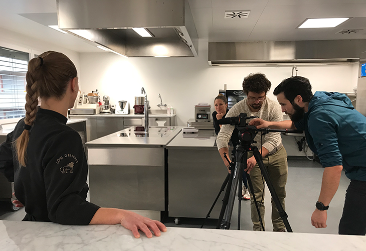 The camera team filming the chocolate machine in the kitchen of Loew Delights.