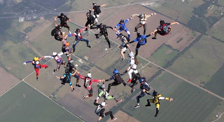 A group of Skydivers in the sky making formations
