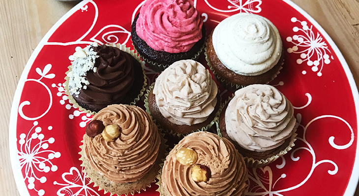 Different cupcakes on a red plate